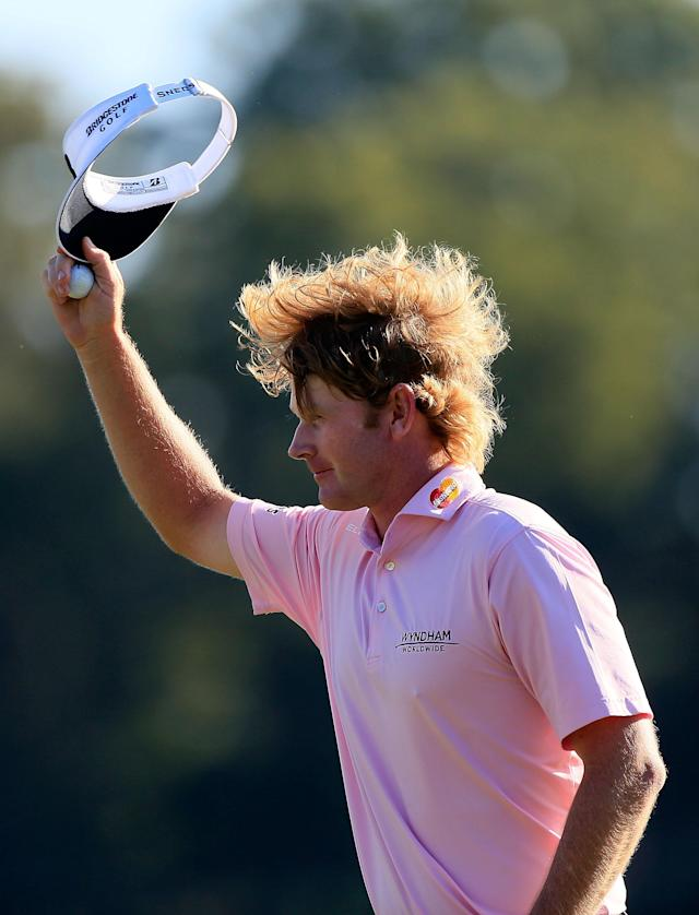 ATLANTA, GA - SEPTEMBER 23: Brandt Snedeker celebrates after holing a chip shot for birdie on the 17th hole during the final round of the TOUR Championship by Coca-Cola at East Lake Golf Club on September 23, 2012 in Atlanta, Georgia. (Photo by Sam Greenwood/Getty Images)