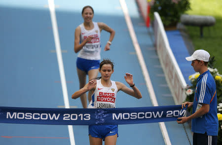 FILE PHOTO: Elena Lashmanova of Russia (front) crosses the finish line to win the women's 20 km race walk final ahead of teammate Anisya Kirdyapkina during the IAAF World Athletics Championships at the Luzhniki stadium in Moscow August 13, 2013. REUTERS/Phil Noble