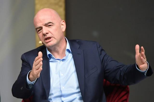 FIFA President Gianni Infantino speaking in February - his federaton is urging clubs and players to reach agreement on wage cuts (AFP Photo/Attila KISBENEDEK)