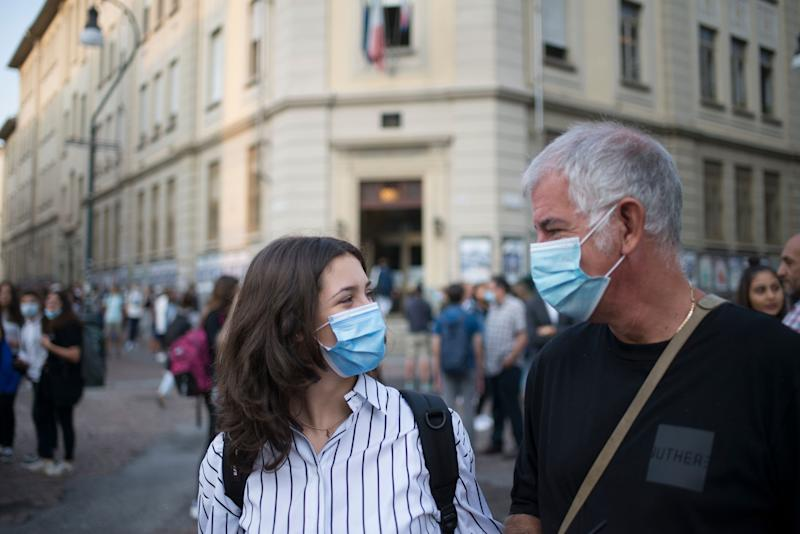 TURIN, ITALY - SEPTEMBER 14: People wear protective masks outside a school on Liceo Classico Gioberti of Torino on September 14, 2020 in Turin, Italy. The Italian Ministry of Education has indicated the opening of state schools on September 14, 2020, the first day of state school after the Covid-19 pandemic. (Photo by Stefano Guidi/Getty Images) (Photo: Stefano Guidi via Getty Images)