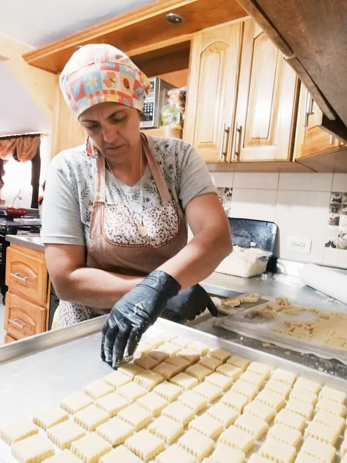 Gloria Quintero works at her bakery business in her kitchen in Granada, Colombia.