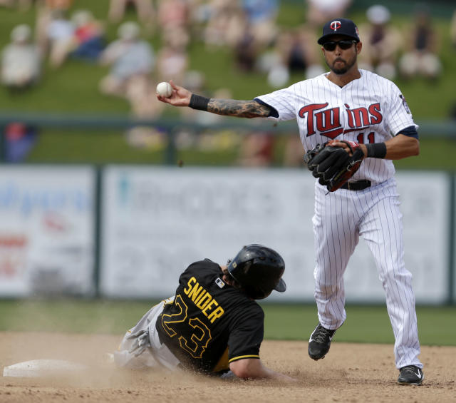 Pittsburgh Pirates right fielder Travis Snider (23) is forced at second as Minnesota Twins shortstop Jason Bartlett (11) trows to first on a double play off the bat of Pedro Alvarez in the fifth inning of an exhibition baseball game in Fort Myers, Fla., Wednesday, March 12, 2014. (AP Photo/Gerald Herbert)