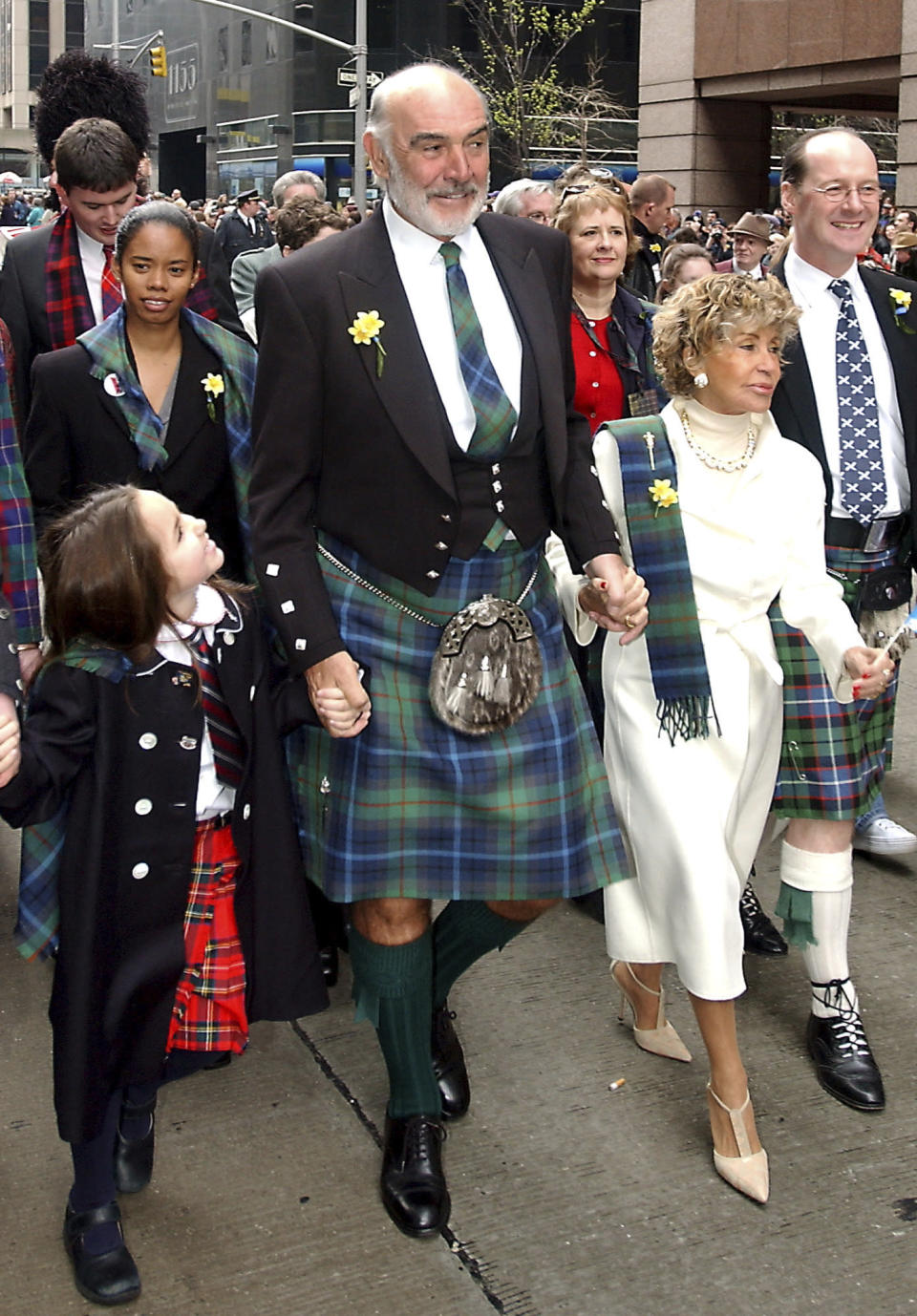 FILE - In this file photo dated Saturday, April 6, 2002, Scottish actor Sean Connery, center, leads a procession up New York's Sixth Avenue as part of a bagpipe band of about 10,000, billed as the world's largest pipe and drum parade. The parade was to benefit cancer victims through the Marie Curie Cancer Care organization, and the New York-based Gilda's Club Worldwide, a support network named after the late actress Gilda Radner. Scottish actor Sean Connery, considered by many to have been the best James Bond, has died aged 90, according to an announcement from his family. (AP Photo/ Stephen Chernin, FILE)