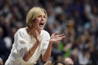 Connecticut associate head coach Chris Dailey calls to her team in the first half of an NCAA college basketball game against Oklahoma, Sunday, Dec. 22, 2019, in Uncasville, Conn. (AP Photo/Jessica Hill)