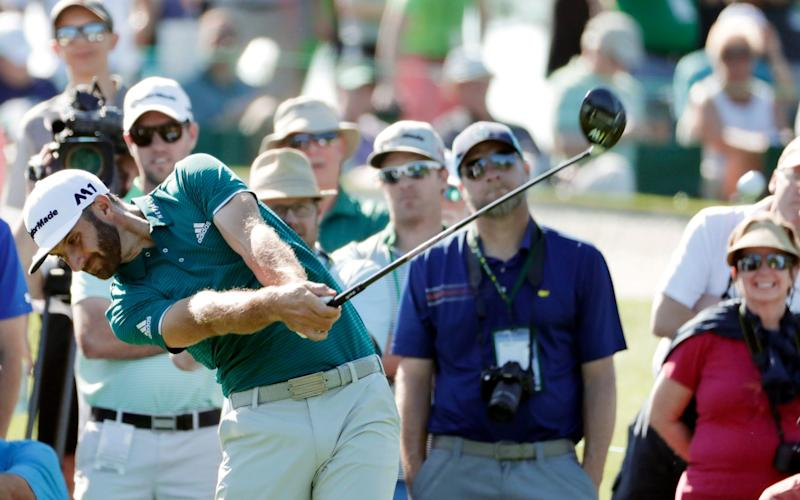 Dustin Johnson hits his tee shot on the third hole during a practice round for the Masters golf tournament Tuesday, April 4, 2017, in Augusta, Ga - Credit: Matt Slocum/AP Photo