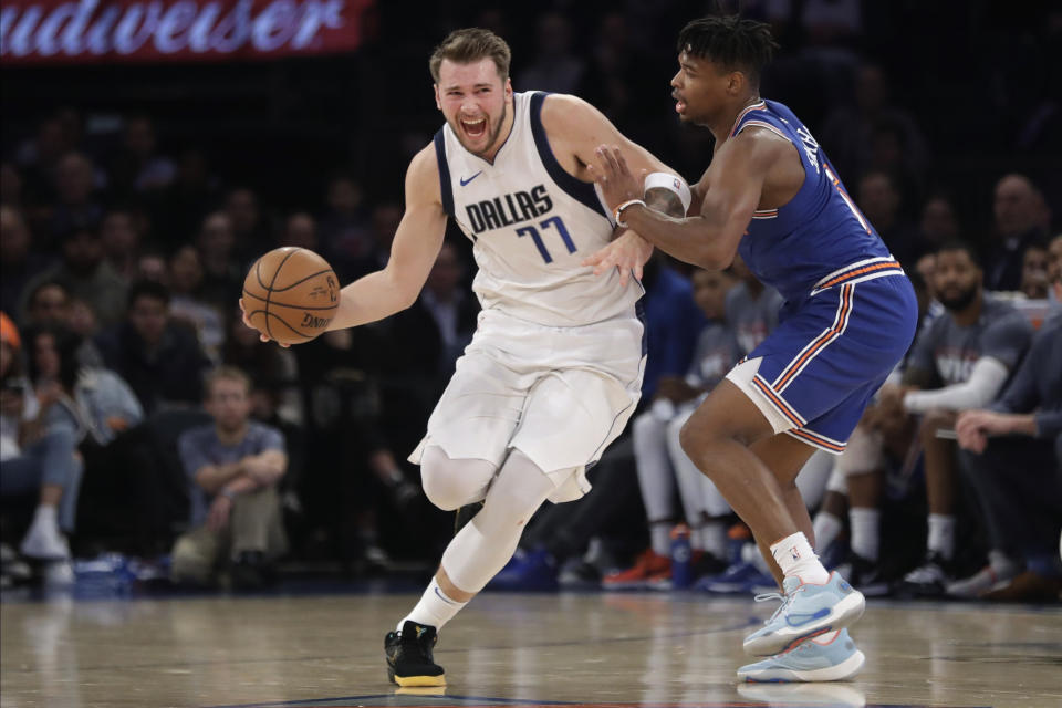 New York Knicks' Dennis Smith Jr., right, defends against Dallas Mavericks' Luka Doncic (77) during the first half of an NBA basketball game Thursday, Nov. 14, 2019, in New York. (AP Photo/Frank Franklin II)