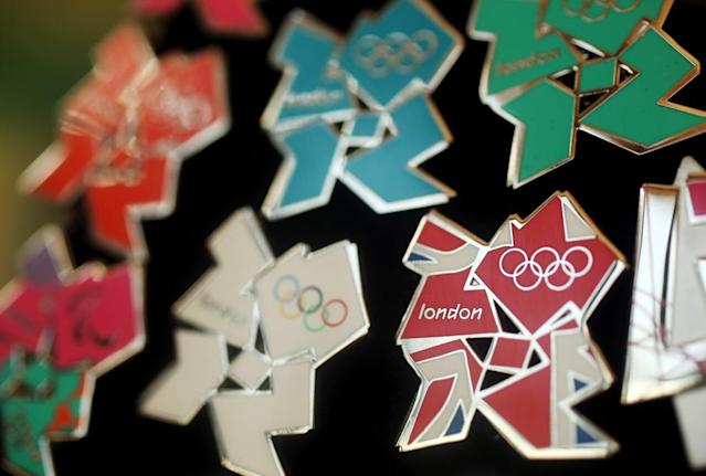 London 2012 pin badges go on display at the launch of the London Olympic Games official merchandise on July 30, 2010 in London, England. The merchandise is being launched with two years to go before the Games begin and features a range of goods including: clothing, towels, bedding, ceramics, stamps, coins, badges, mascot toys and soft furnishings. (Photo by Oli Scarff/Getty Images)