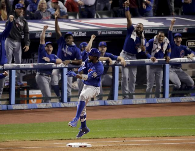 <p>Chicago Cubs' Dexter Fowler celebrates after a home run against the Cleveland Indians during the first inning of Game 7 of the Major League Baseball World Series Wednesday, Nov. 2, 2016, in Cleveland. (AP Photo/Charlie Riedel) </p>
