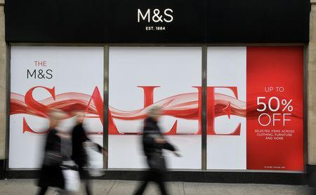 Shoppers walk past sale signs at a branch of the British clothing and food retailer Marks and Spencer on Oxford Street in London, Britain, January 3, 2019. REUTERS/Toby Melville
