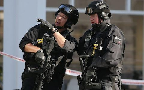 <span>Armed police officers outside the evacuated Parsons Green station</span> <span>Credit: DANIEL LEAL-OLIVAS/AFP </span>