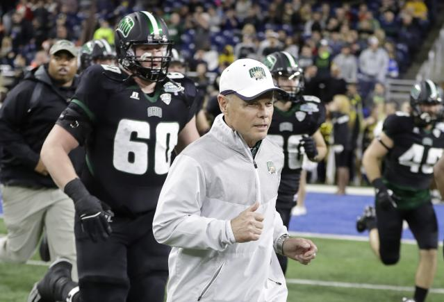 FILE - In this Dec. 2, 2016, file photo, Ohio head coach Frank Solich runs onto the field with his team before the Mid-American Conference championship NCAA college football game against Western Michigan, in Detroit. Frank Solich will return to Nebraska this winter to receive the Tom Osborne Legacy Award from his former boss. The Football Writers Association of America announced Friday, May 25, 2018, that Solich would be honored during the Outland Trophy banquet in Omaha on Jan. 9.(AP Photo/Carlos Osorio, File)