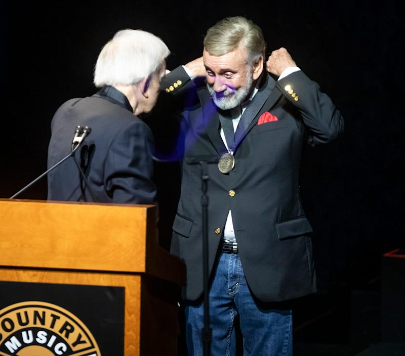 Ralph Emery presents Ray Stevens with his medallion during the Medallion Ceremony at the Country Music Hall of Fame Sunday, October 20, 2019.