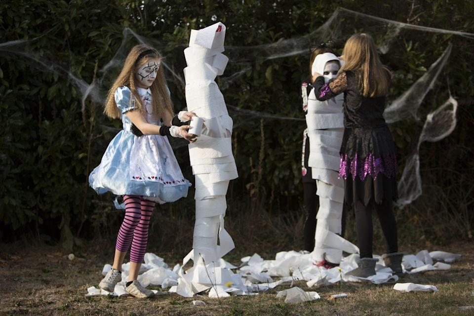 """<p>Divide kids into groups of two and have one wrap the other up like a mummy as quickly as possible and whichever team's mummy runs to the finish line first wins.</p><p><strong><strong>RELATED:</strong></strong> <a href=""""https://www.goodhousekeeping.com/holidays/halloween-ideas/g385/popular-kids-halloween-costumes/"""" rel=""""nofollow noopener"""" target=""""_blank"""" data-ylk=""""slk:65 Kids' Halloween Costume Ideas for Easy, Creative, and Unique Trick-or-Treating"""" class=""""link rapid-noclick-resp"""">65 Kids' Halloween Costume Ideas for Easy, Creative, and Unique Trick-or-Treating</a></p>"""