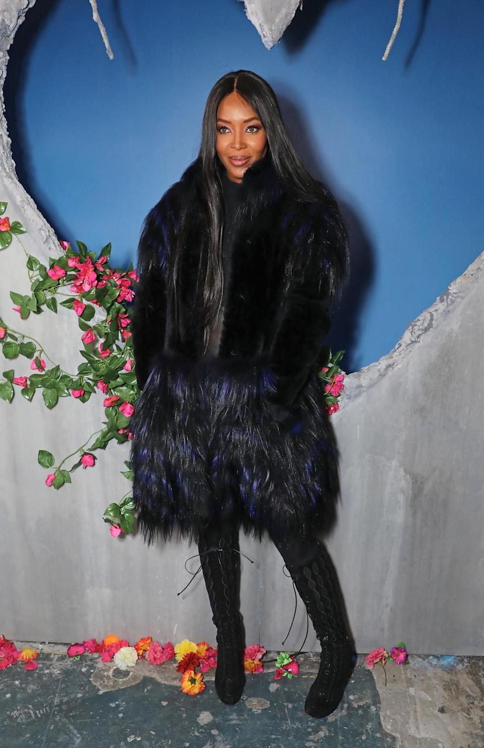 <p>Naomi Campbell cosied up in a huge fur coat. <i>[Photo: Getty]</i> </p>