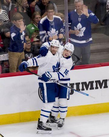 Oct 7, 2018; Chicago, IL, USA; Toronto Maple Leafs center John Tavares (91) celebrates his hat trick goal with center Mitchell Marner (16) during the third period against the Chicago Blackhawks at United Center. Mandatory Credit: Patrick Gorski-USA TODAY Sports