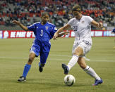 Mary Abigail Wambach #20 of the United States and Denny Vargas #3 of the Dominican Republic compete for the ball during their game at the 2012 CONCACAF Women's Olympic Qualifying Tournament at BC Place on January 20, 2012 in Vancouver, British Columbia, Canada. (Photo by Jeff Vinnick/Getty Images)