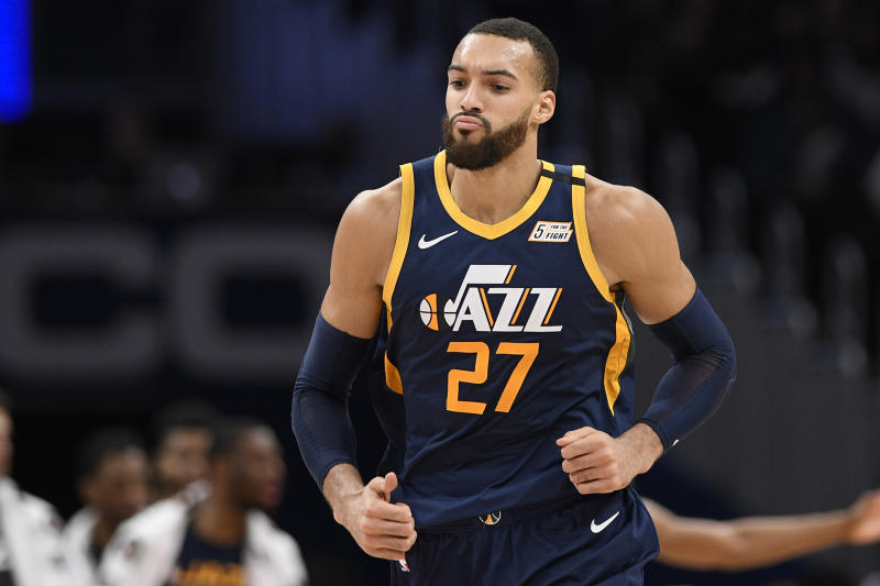 Utah Jazz center Rudy Gobert (27) runs on the court during the second half of an NBA basketball game against the Washington Wizards, Sunday, Jan. 12, 2020, in Washington. The Jazz won 127-116. (AP Photo/Nick Wass)