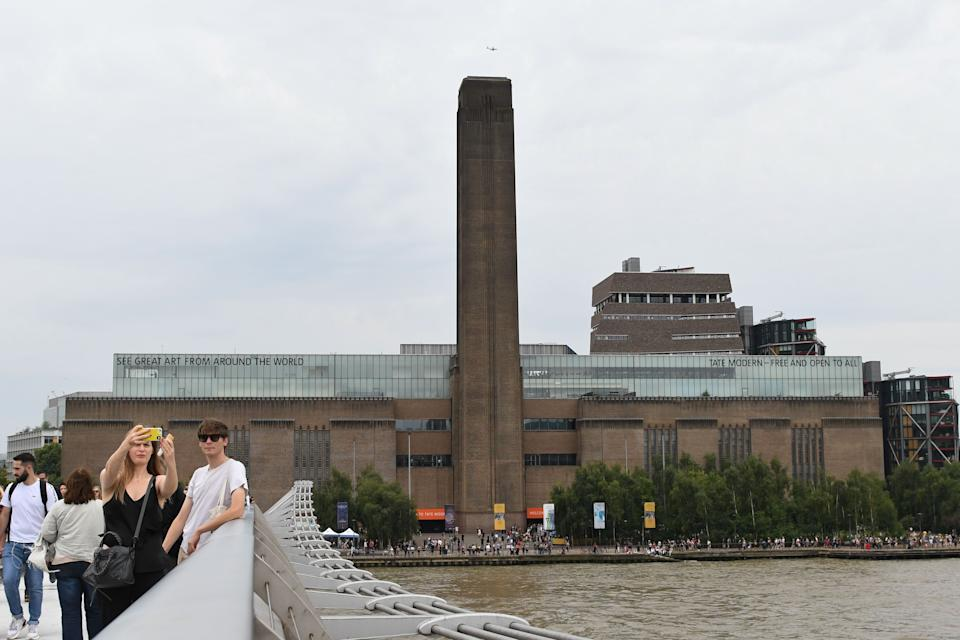 """A general view shows the Tate Modern gallery on the southern bank of the River Thames in London on August 4, 2019 after it was put on lock down and evacuated after an incident involving a child falling from height and being airlifted to hospital. - London's Tate Modern gallery was evacuated on Sunday after a child fell """"from a height"""" and was airlifted to hospital. A teenager was arrested over the incident, police said, without giving any details of the child's condition. (Photo by Daniel SORABJI / AFP)        (Photo credit should read DANIEL SORABJI/AFP/Getty Images)"""