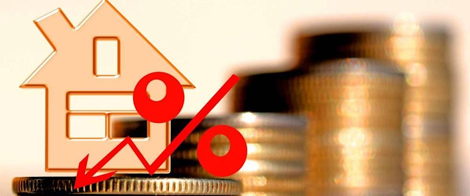 Red percent sign on a background of money.  The concept of price change in the market