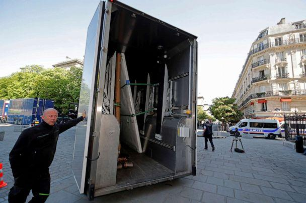 PHOTO: Large artworks are seen in a truck after being removed from Notre-Dame Cathedral to be secured after a massive fire devastated large parts of the gothic cathedral in Paris, April 19, 2019. (Philippe Wojazer/AP)