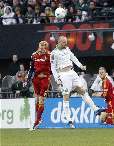 Portland Timbers forward Kris Boyd, right, heads the ball away from Real Salt Lake defender Nat Borchers during the first half of their MLS soccer game in Portland, Ore., Saturday, March 31, 2012.(AP Photo/Don Ryan)