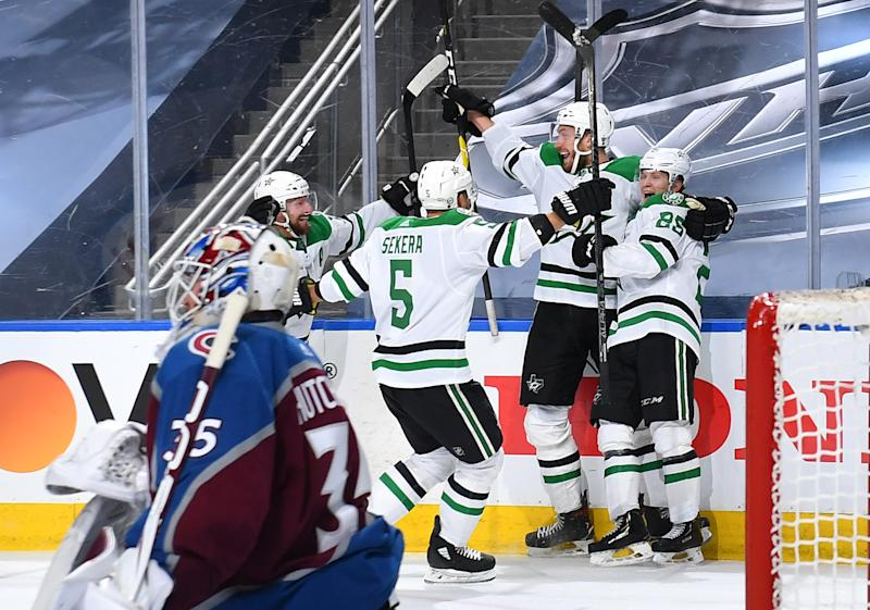 EDMONTON, ALBERTA - SEPTEMBER 04: Joel Kiviranta #25 of the Dallas Stars celebrates with Jamie Oleksiak #2, Andrej Sekera #5 and Blake Comeau #15 as goaltender Michael Hutchinson #35 of the Colorado Avalanche looks on after Kiviranta scored the game-winning goal in the first overtime period of Game Seven of the Western Conference Second Round of the 2020 NHL Stanley Cup Playoff between the Dallas Stars and the Colorado Avalanche at Rogers Place on September 04, 2020 in Edmonton, Alberta. The Stars defeated the Avalanche 5-4 in overtime to win the best of seven game series 4-3. (Photo by Andy Devlin/NHLI via Getty Images)