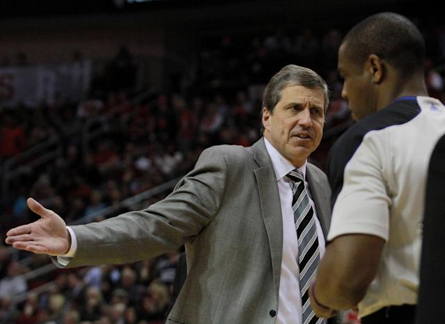 Washington Wizards head coach Randy Wittman argues a call with a referee during an NBA basketball game against the Houston Rockets the second half in Houston, Wednesday, Feb. 12, 2014. (AP Photo/Richard Carson)