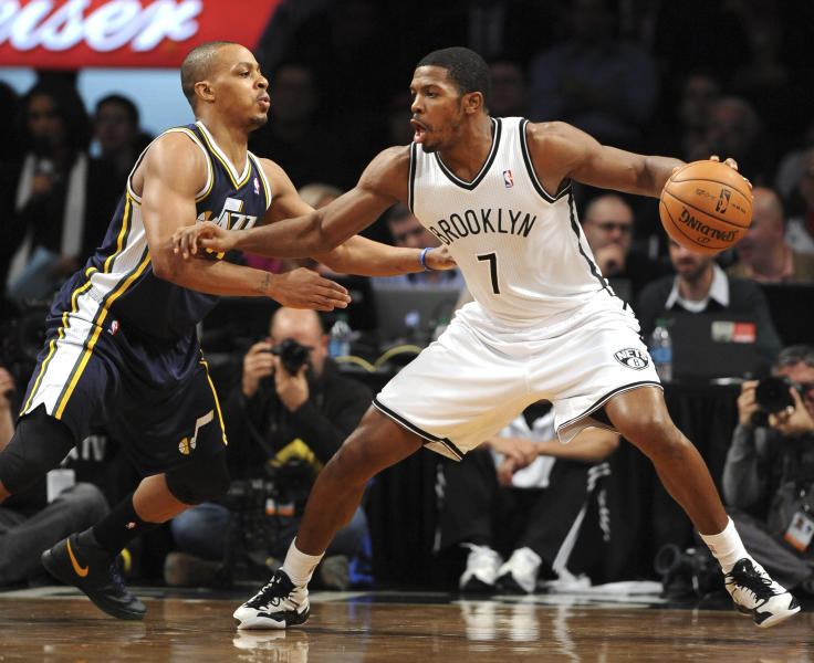 """FILE - In this Dec. 18, 2012, file photo, Brooklyn Nets shooting guard Joe Johnson (7) drives the ball around Utah Jazz point guard Randy Foye (8) in an NBA basketball game at Barclays Center in New York. The Nets' 2012 acquisition of Johnson to play with point guard Deron Williams was a pairing that was touted as """"Brooklyn's Backcourt."""" (AP Photo/Kathy Kmonicek, File)"""