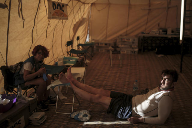 A competitor receives treatment after taking part in the 33rd edition of Marathon des Sables, in the Sahara desert, near Merzouga, southern Morocco, Friday, April 13, 2018. (AP Photo/Mosa'ab Elshamy)