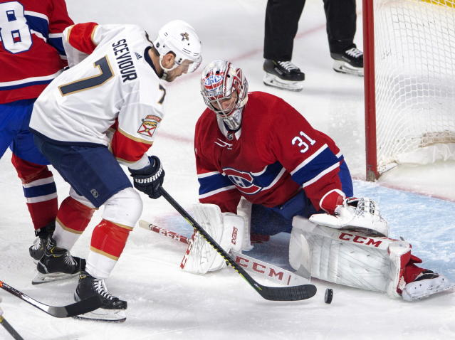 Montreal Canadiens goaltender Carey Price (31) makes the save against Florida Panthers center Colton Sceviour (7) during the first period of an NHL hockey game Tuesday, March 26, 2019, in Montreal. (Ryan Remiorz/The Canadian Press via AP)