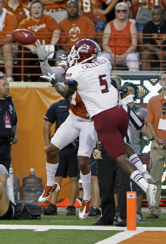 New Mexico State cornerback George Callender (5) intercepts a David Ash pass intended for Texas' Mike Davis during the second quarter of an NCAA college football game Saturday Aug. 31, 2013, in Austin, Texas. (AP Photo/Michael Thomas)