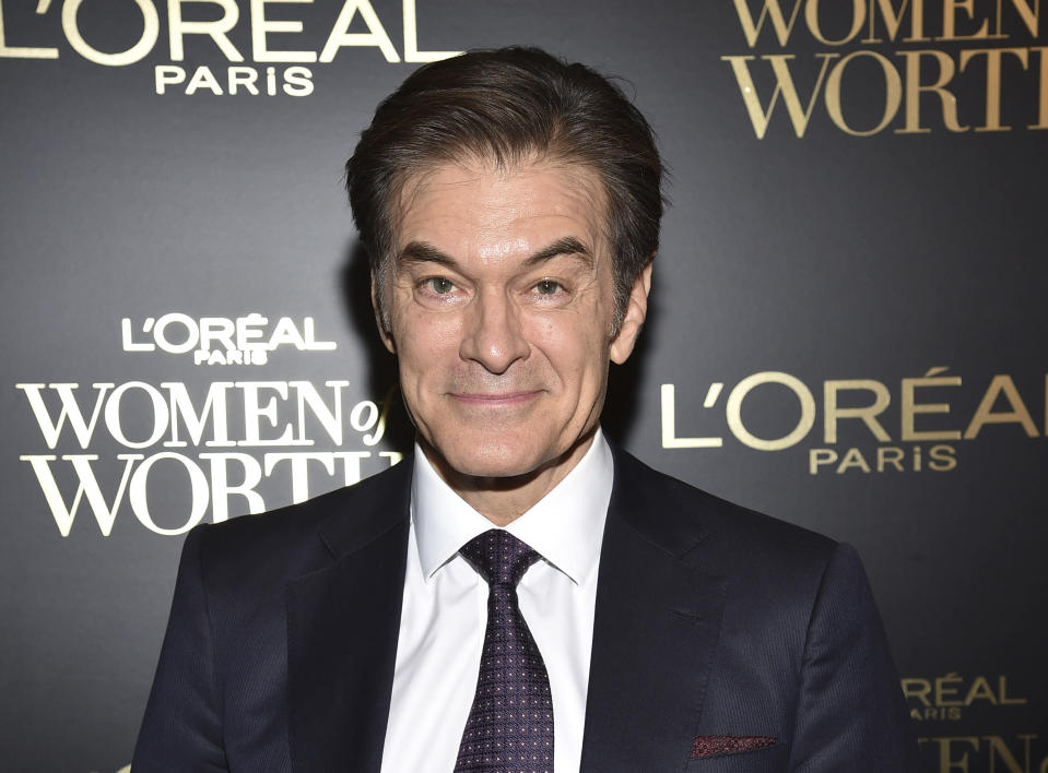 """FILE - This Dec. 4, 2019 file photo shows Dr. Mehmet Oz at the 14th annual L'Oreal Paris Women of Worth Gala in New York. Oz, the cardiac surgeon and longtime host of TV's """"Dr. Oz Show,"""" rendered aid a 60-year-old traveler at Newark Liberty International Airport on Monday, March 1, 2021. Oz, along with Port Authority Officer Jeffrey Croissant, performed CPR on the man until three more officers arrived to provide oxygen and activate a defibrillator. (Photo by Evan Agostini/Invision/AP, File)"""