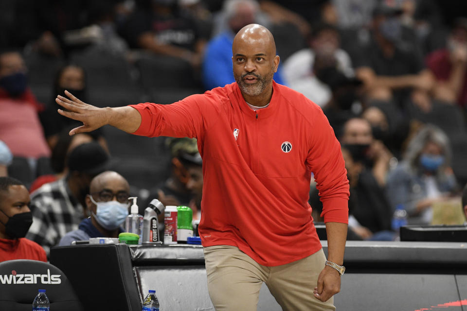 Washington Wizards head coach Wes Unseld Jr. gestures during the first half of an NBA preseason basketball game against the New York Knicks, Saturday, Oct. 9, 2021, in Washington. (AP Photo/Nick Wass)