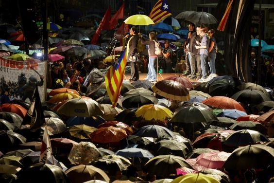 People attend a protest in Girona against the sentencing of independence leaders (EPA)