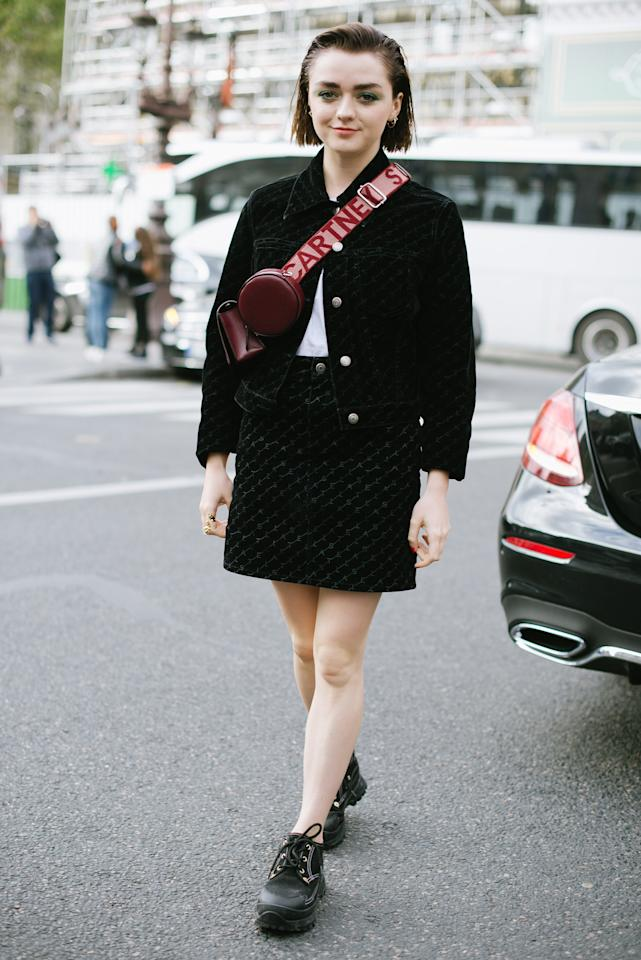 Maisie added tiny details — slicked back hair, a red crossbody, and green eye shadow — to jazz up this black skirt and matching jacket.