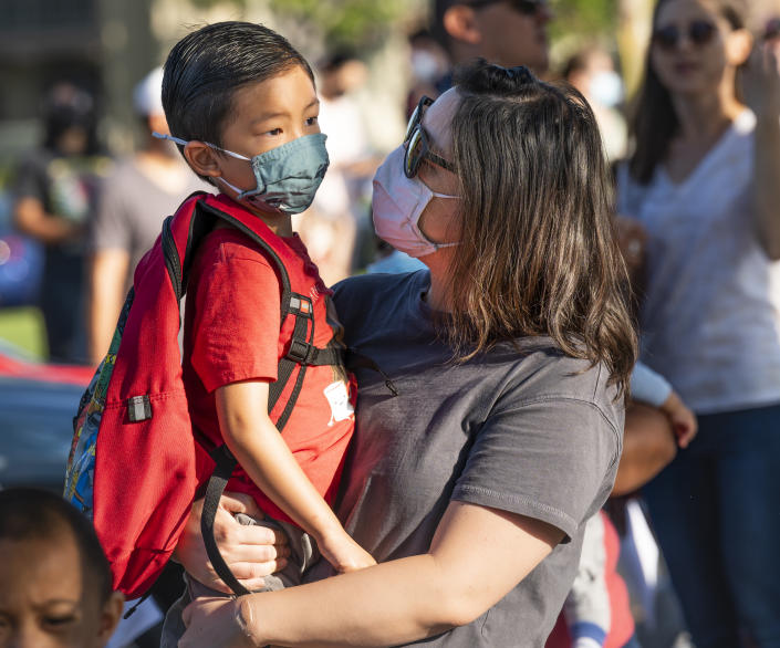 Tustin, CA - August 11: A student talks with his mom before his first day of kindergarten at Tustin Ranch Elementary School in Tustin, CA on Wednesday, August 11, 2021. (Photo by Paul Bersebach/MediaNews Group/Orange County Register via Getty Images)