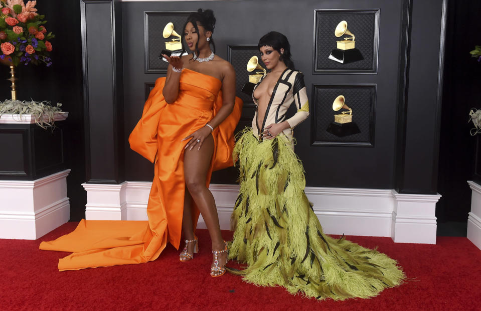 Megan Thee Stallion, left, and Doja Cat arrive at the 63rd annual Grammy Awards at the Los Angeles Convention Center on Sunday, March 14, 2021. (Photo by Jordan Strauss/Invision/AP)