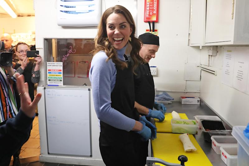 The Duchess of Cambridge, known as the Countess of Strathearn while in Scotland, helps to prepare food during a visit to the Social Bite cafe in Aberdeen, to meet with locals for her Early Childhood survey. (Photo by Andrew Milligan/PA Images via Getty Images)