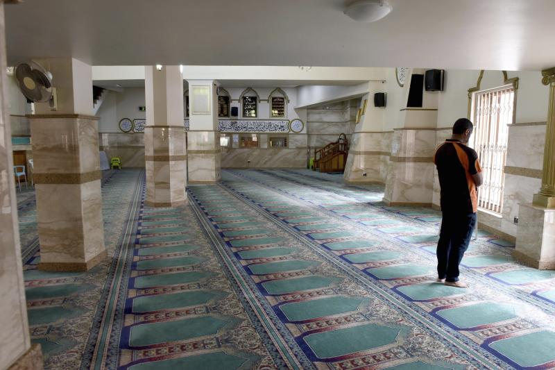 A worshipper prays in the Auwal Mosque, the oldest in the country, in Cape Town, South Africa, Wednesday Sept.18, 2019. Prince Harry and his wife, Meghan, along with their infant son, Archie, are making their first official tour to Africa and will be visiting the landmark as part of their tour on South Africa's Heritage Day, Tuesday. (AP Photo/Nasief Manie)