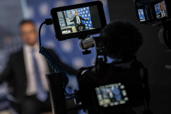 Peter Szijjarto, Hungary's minister of foreign affairs and trade, is displayed in a video camera monitors as he speaks during an interview with the Associated Press at United Nations headquarters, Thursday, Sept. 23, 2021, during the 76th Session of the U.N. General Assembly in New York. (AP Photo/John Minchillo)