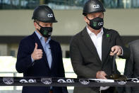 FILE - In this Jan. 25, 2021, file photo, Q2 Holdings Inc. CEO Matt Flake, left, and Austin FC majority owner Anthony Precourt, right, take part in a ribbon-cutting ceremony as the team's new stadium is named Q2 Stadium in Austin, Texas. Austin FC is MLS's newest expansion team and had to build the $260-million facility and a team roster amid the global pandemic. Austin FC opens the 2021 season Saturday, April 17, 2021, at Los Angeles FC. (AP Photo/Eric Gay, File)