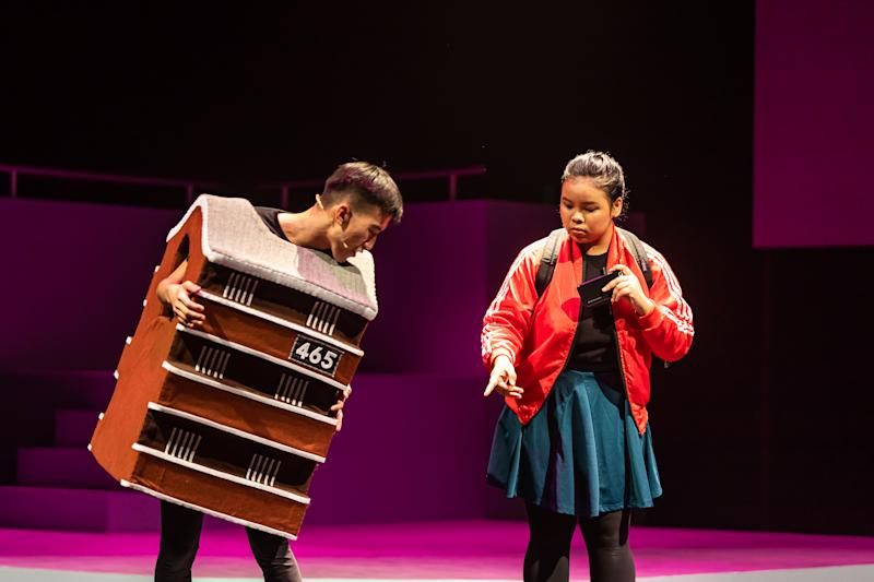 "A young actress (right) from The Community Theatre having a ""conversation"" with a fellow actor dressed up as an HDB block of rental flats. (PHOTO: ArtsWok Collaborative)"