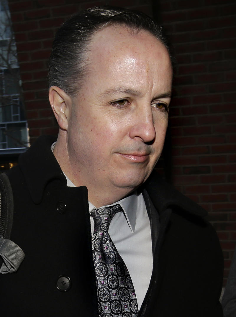 FILE - In  this March 16, 2017, file photo, Barry Cadden arrives at the federal courthouse in Boston. A verdict has been reached Wednesday, March 22, 2017, in the case. Cadden, president of New England Compounding Center, faces multiple counts in a fungal meningitis outbreak from tainted steroids manufactured by the pharmacy, which killed dozens and sickened hundreds of people in 2012. (AP Photo/Steven Senne, File)