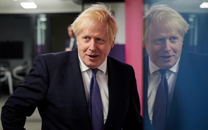 "Prime Minister Boris Johnson visits the headquarters of Octopus Energy, a British ""tech unicorn""  - Getty"
