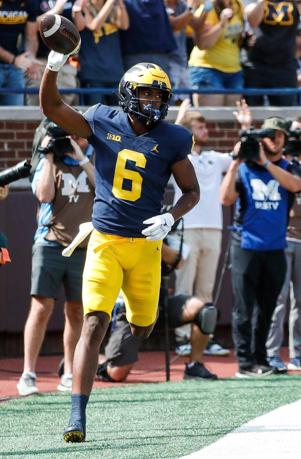 Michigan wide receiver Cornelius Johnson (6) scores a touchdown against Northern Illinois during the first half at Michigan Stadium in Ann Arbor on Saturday, Sept. 18, 2021.