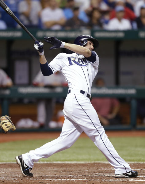 Tampa Bay Rays' Matt Joyce hits a fourth-inning, two-run infield single off Boston Red Sox starting pitcher John Lackey during a baseball game Tuesday, May 14, 2013, in St. Petersburg, Fla. Rays Jose Molina and Yunel Escobar scored on the hit. (AP Photo/Chris O'Meara)