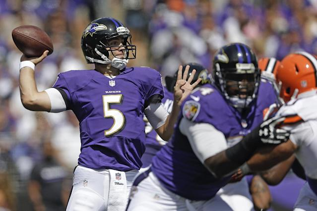 Baltimore Ravens quarterback Joe Flacco passes the ball during the first half of a NFL football game against the Cleveland Browns in Baltimore, Md., Sunday, Sept. 15, 2013. (AP Photo/Patrick Semansky)