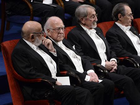 Nobel prize laureates (L-R) Francois Englert and Peter Higgs in Physics sit with Martin Karplus and Michael Levitt in Chemistry during the 2013 Nobel Prize award ceremony in Stockholm December 10, 2013. REUTERS/Claudio Bresciani