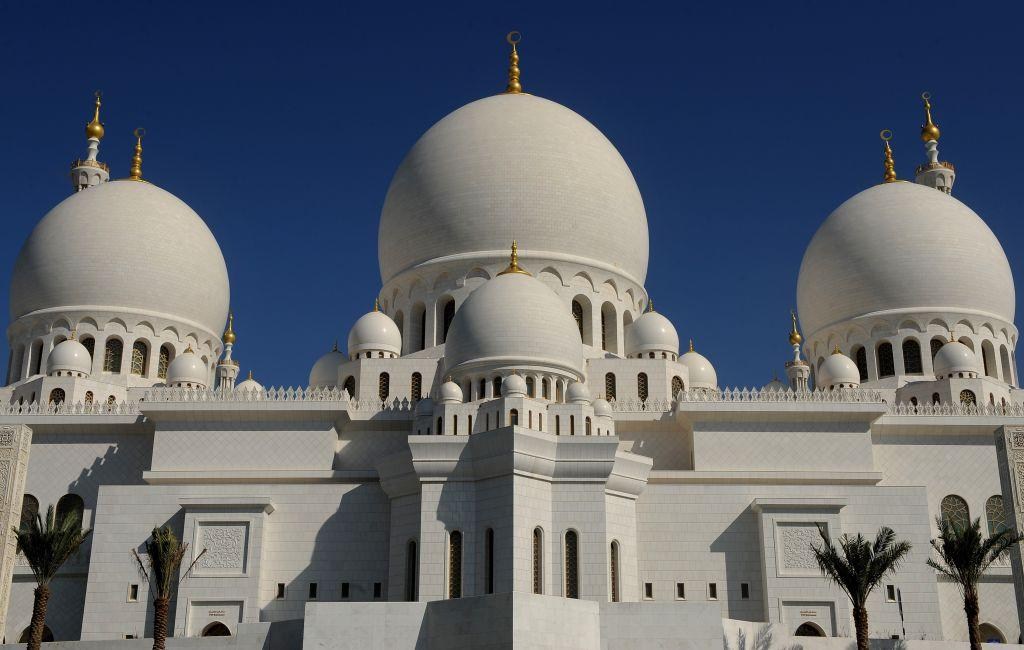 <p>ABU DHABI, UNITED ARAB EMIRATES: The Sheikh Zayed Mosque backdropped by a clear blue sky in Abu Dhabi, United Arab Emirates. The Mosque, named after Sheikh Zayed bin Sultan Al Nahyan, is the biggest mosque in the United Arab Emirates.</p>