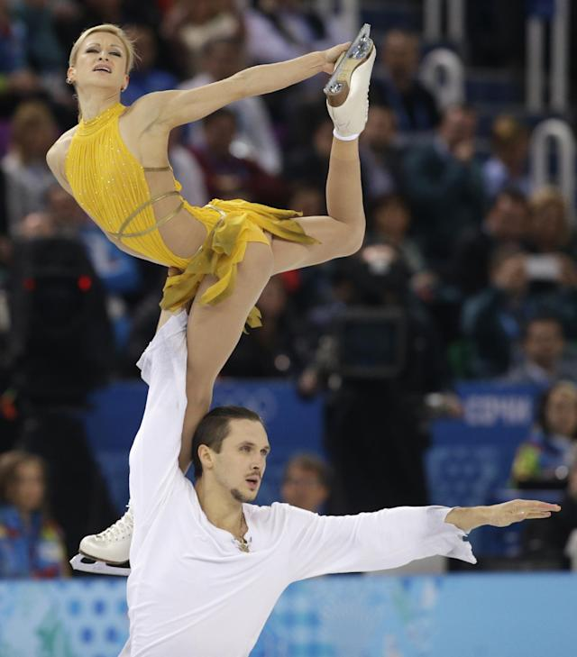 Tatiana Volosozhar and Maxim Trankov of Russia compete in the pairs free skate figure skating competition at the Iceberg Skating Palace during the 2014 Winter Olympics, Wednesday, Feb. 12, 2014, in Sochi, Russia. (AP Photo/Darron Cummings)